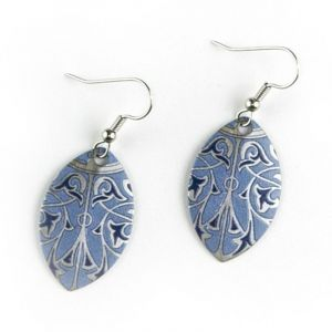 These teardrop shaped earrings, made of printed brass with applied silver gilt, were inspired by design elements of the Minton tile ceiling at Bethesda Terrace Arcade in Central Park. The ceiling is a richly decorated component of the Arcade, which was re
