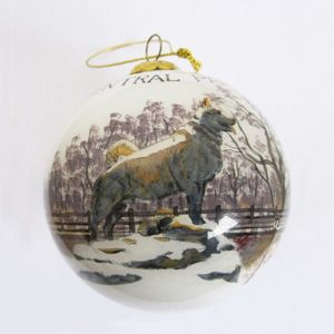This globular glass ornament shows an image of the popular statue of Balto with